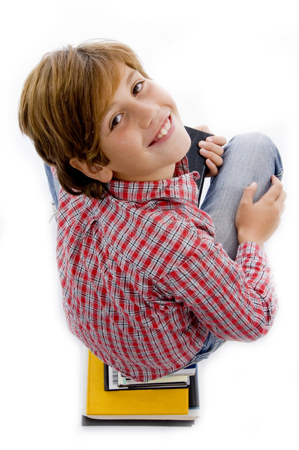 Download Top View Of Boy With Pile Of Books Stock Image - Image: 7417045
