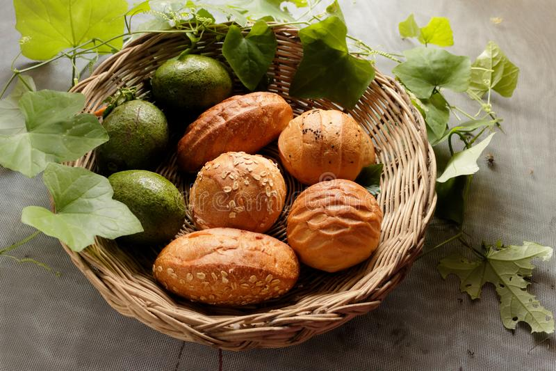 Top view of Bread and avocado in basket decorate by gourd leaf royalty free stock photography