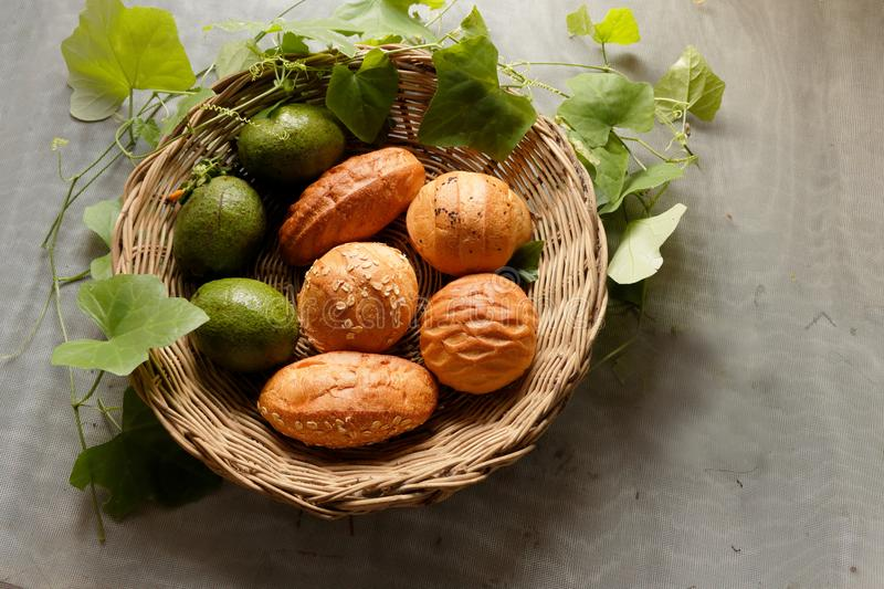 Top view of Bread and avocado in basket decorate by gourd leaf stock images