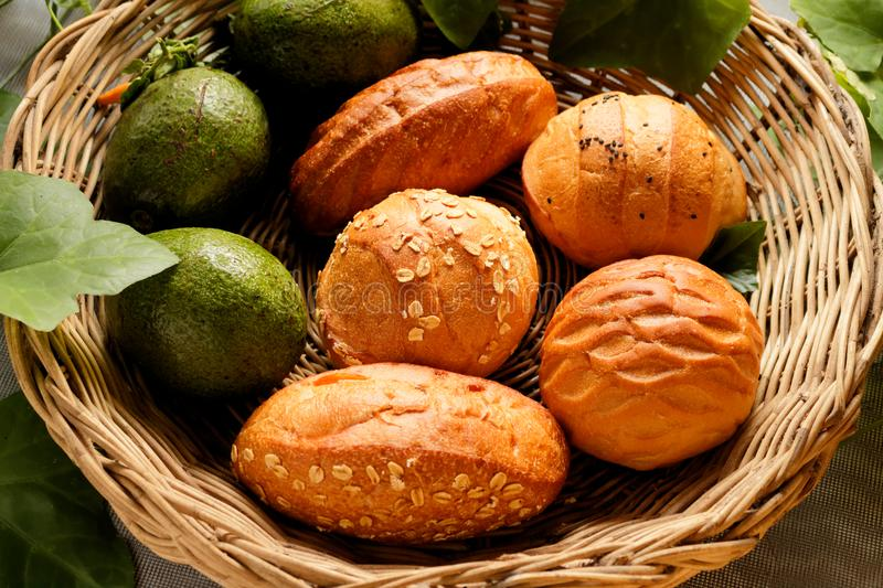 Top view of Bread and avocado in basket decorate by gourd leaf royalty free stock photos