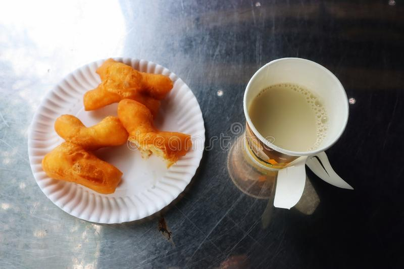 Top view breakfast image  Deep fried dough stick and tofu in a glass on a stainless steel table background. Food, eat, thaifood stock photo