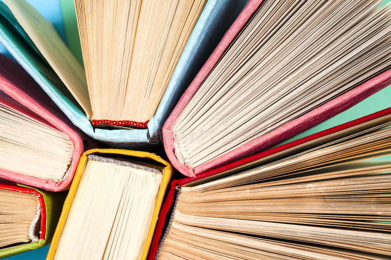 Top view of bright colorful hardback books in a circle. royalty free stock photography