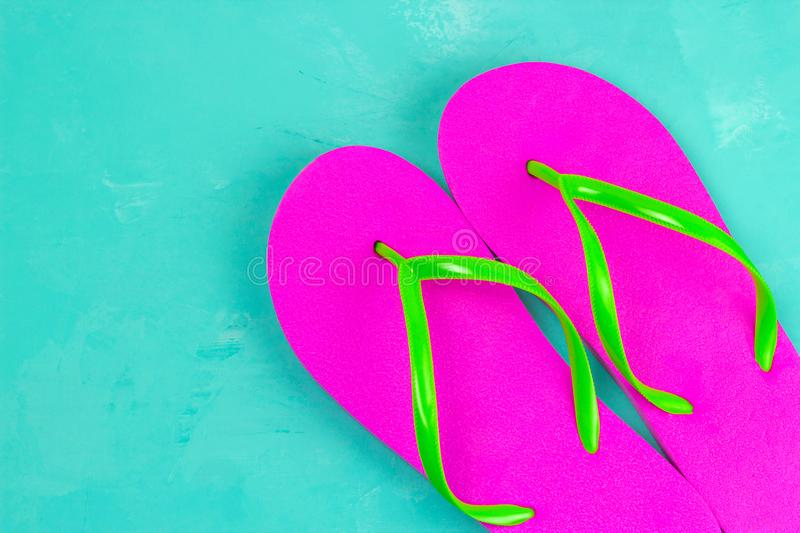 Top view bright pink slippers on a blue background royalty free stock photos