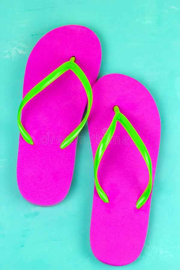 bright pink slippers on a blue background royalty free stock photos