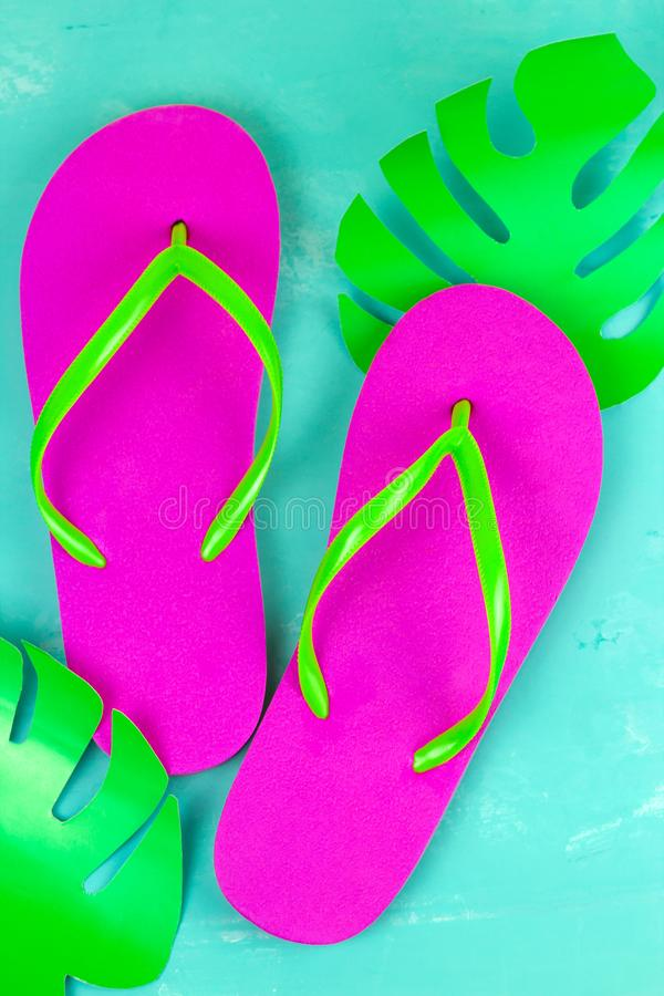 Bright pink slippers on a blue background stock photography