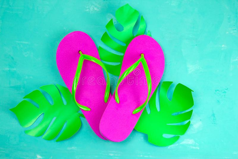Bright pink slippers on a blue background stock image