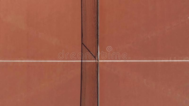 Top view of brown tennis court with net on middle, leisure activity, trainings. Stock photo stock image