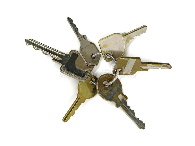 Top view bunch of old vintage different keys isolated on white background. Safety and security concept stock images