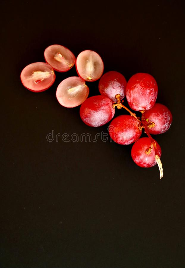 Top view of bunch of pink grapes. royalty free stock images