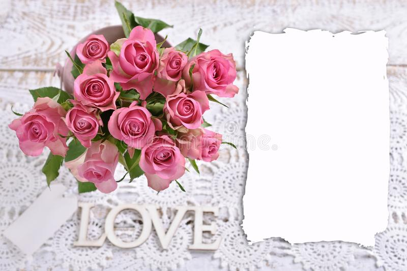 Top view of the bunch of pink roses and copy space for own text. Love background with top view of the bunch of beautiful fresh pink roses and copy space for own stock image