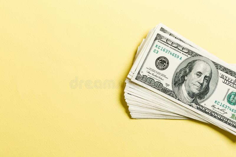 Top view of bundle of 100 dollar bill on colorful backgound. Business concept with copy space.  royalty free stock photo