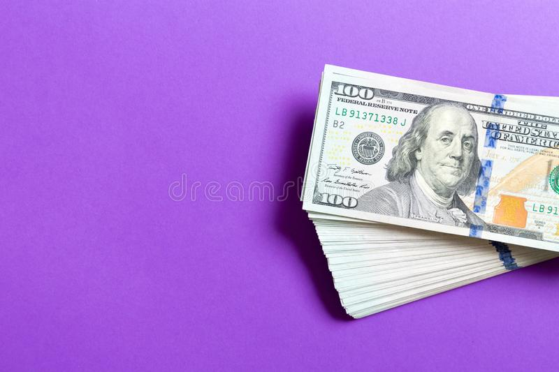 Top view of bundle of 100 dollar bill on colorful backgound. Business concept with copy space.  royalty free stock image