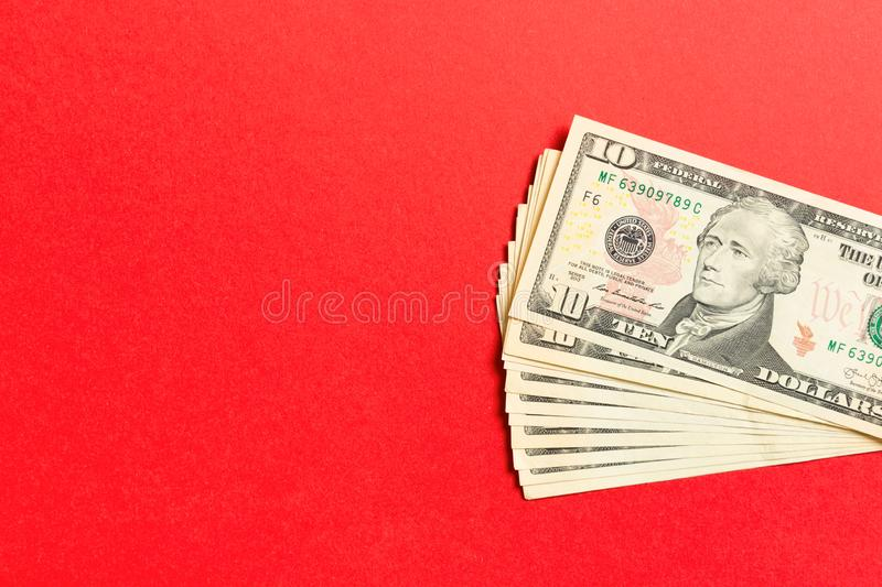 Top view of bundle of 10 dollar bill on colorful backgound. Business concept with copy space.  royalty free stock photography