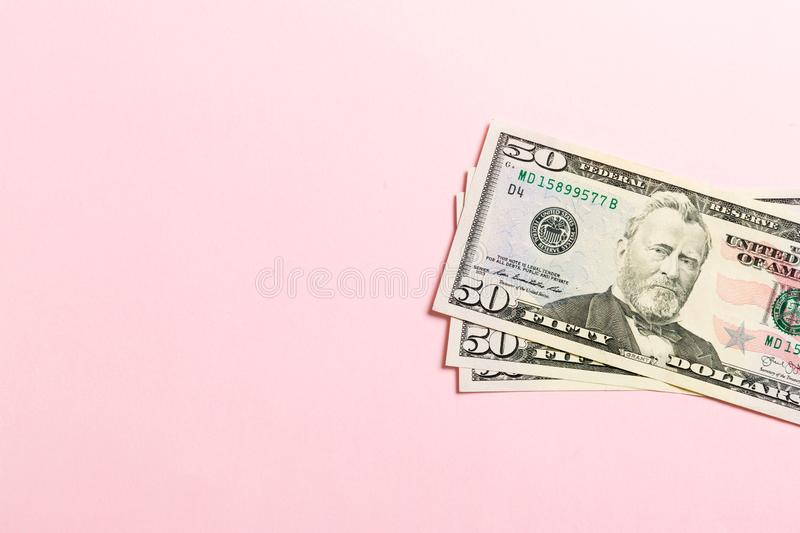 Top view of bundle of 50 dollar bill on colorful backgound. Business concept with copy space.  royalty free stock photo