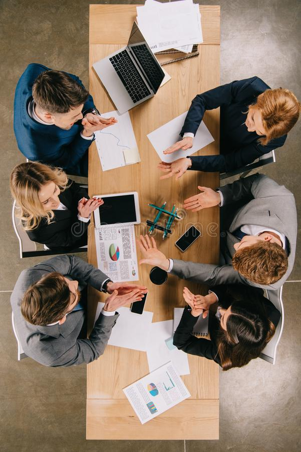 Top view of business colleagues doing construction with pencils at table stock photo