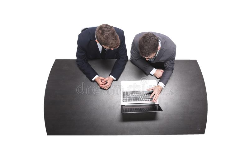 Top view. business colleagues looking together at the screen of the laptop. royalty free stock images