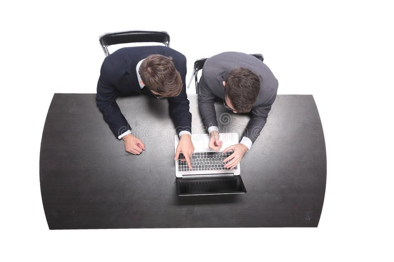 Top view. business colleagues looking together at the screen of the laptop. stock photos