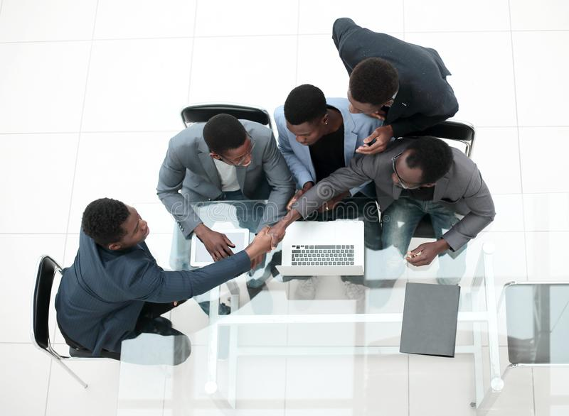 Top view. business colleagues shaking hands during office meeting. royalty free stock photos