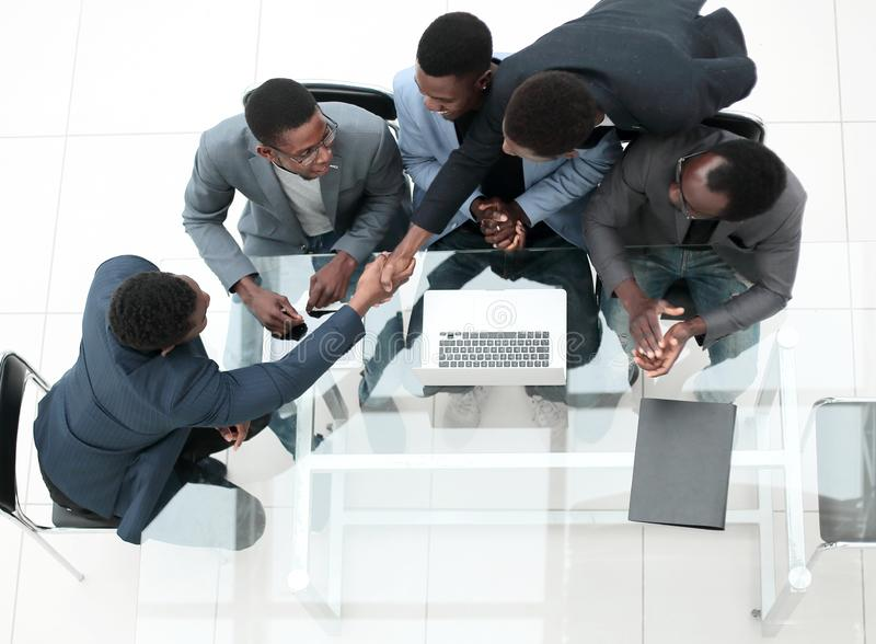 Top view. business colleagues shaking hands during office meeting. stock photos