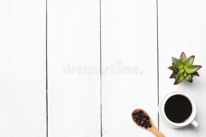 Top view business concept coffee mug and supplies on white wooden floor. royalty free stock image