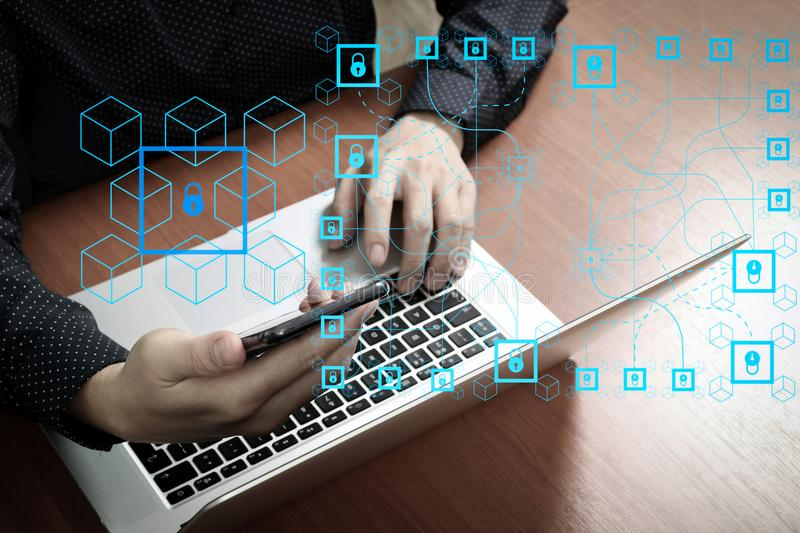 Top view,business man hand using smart phone,laptop, online bank. Blockchain technology concept with diagram of chain and encrypted blocks.business man hand royalty free stock photo