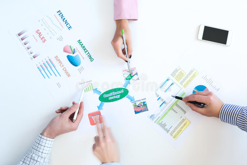 Top View of Business Meeting with Charts on White Desk stock image