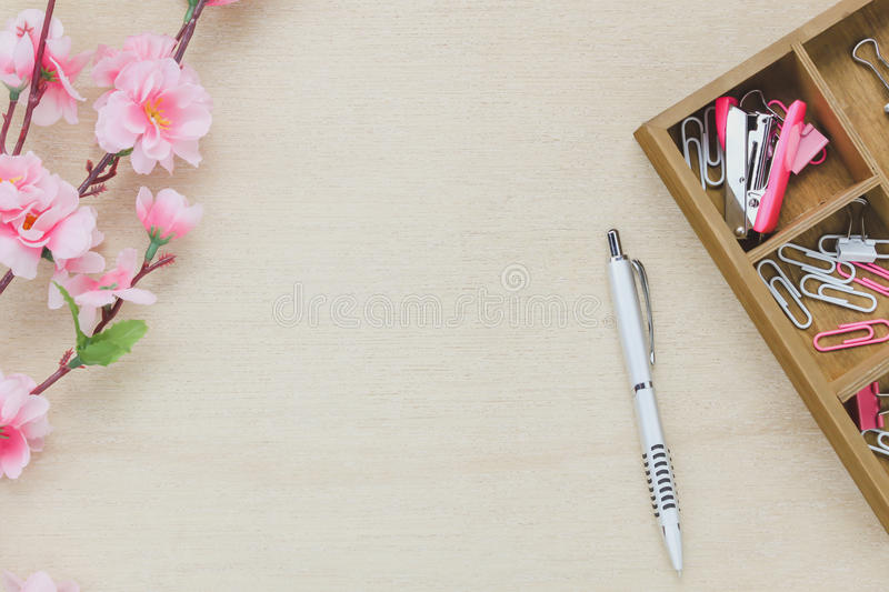 Top view business office desk background. The silver pen coffee beautiful pink flower wood shelf staple clip on wooden table backgtound with copy space royalty free stock photography