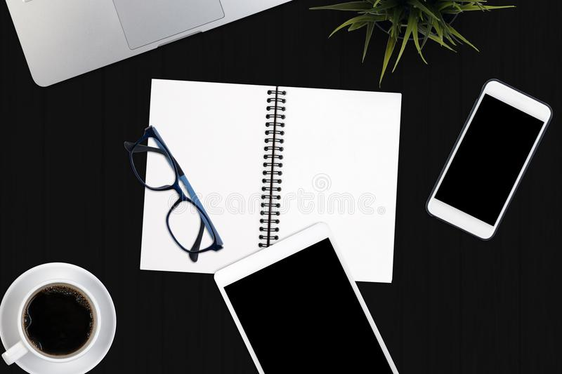 Top view business office supplies. Laptop with notebook and smart phone on white table. Business concept. Home office workspace. stock photo