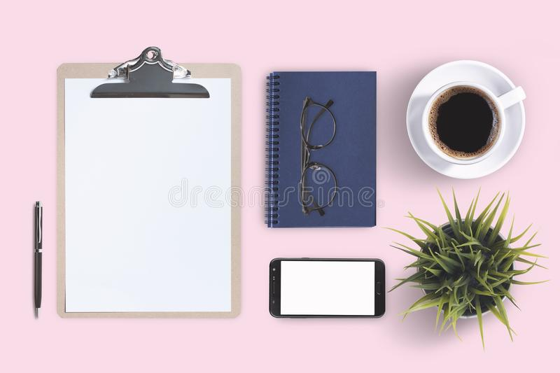 Top view business office supplies. Laptop with notebook and smart phone on white table. Business concept. Home office workspace. royalty free stock photography