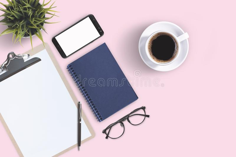 Top view business office supplies. Laptop with notebook and smart phone on white table. Business concept. Home office workspace. Top view business office stock photo