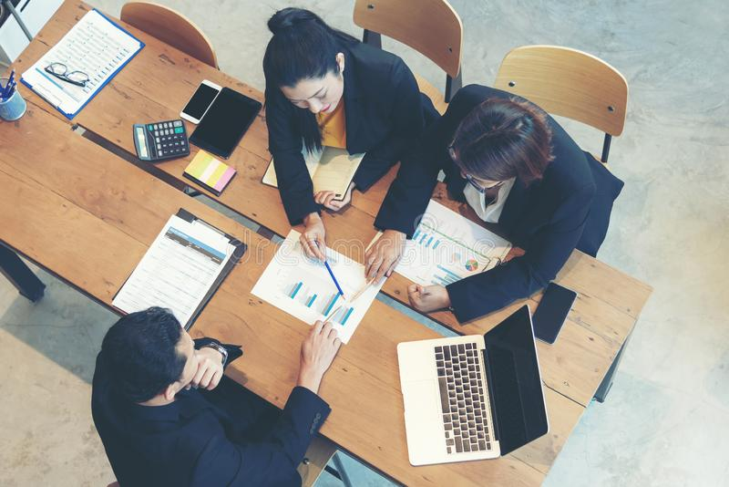Top view business partners training and discussing contract and graph of financial report development. stock images