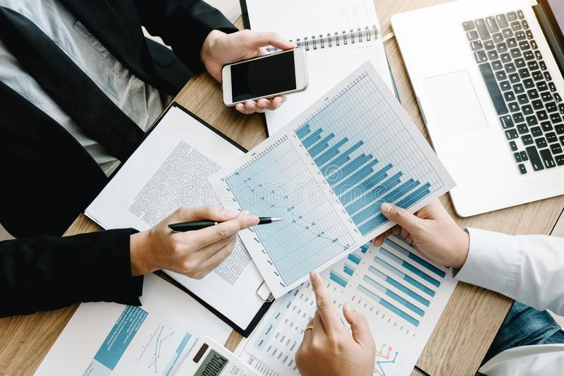 Top view of business people discussing with colleagues with entrepreneurs are planning finance in office room stock image
