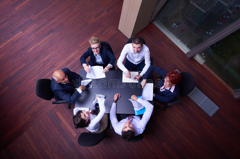 Top view of business people group throwing dociments in air stock photo
