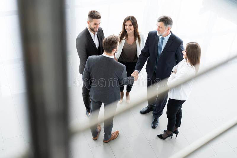 Top view of business people shaking hands, finishing up a meeting - Welcome to business. stock photos