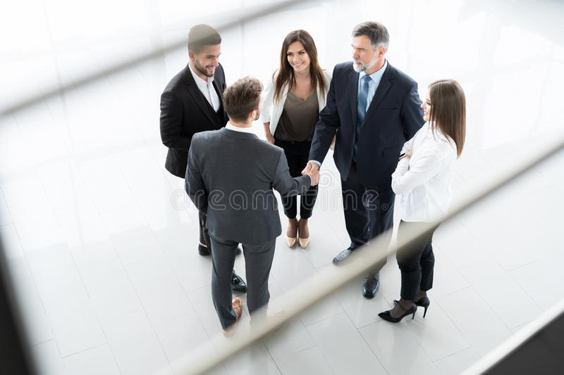 Top view of business people shaking hands, finishing up a meeting - Welcome to business. stock images