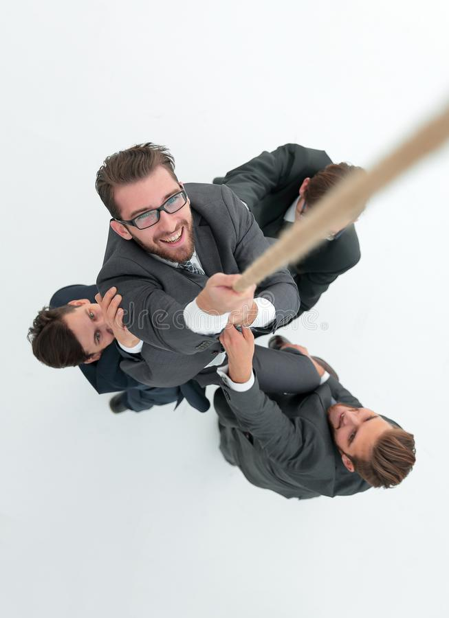 Top view .business team helps the boss to climb up. royalty free stock photo