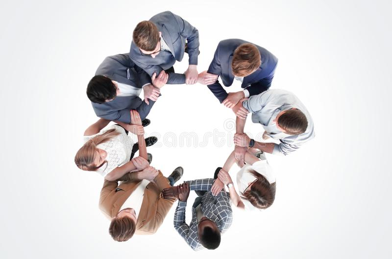 Top view.the business team holds each other`s hands stock photos
