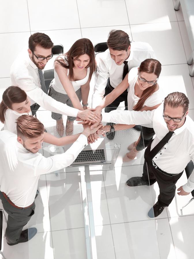 Top view .business team putting their hands together stock photography