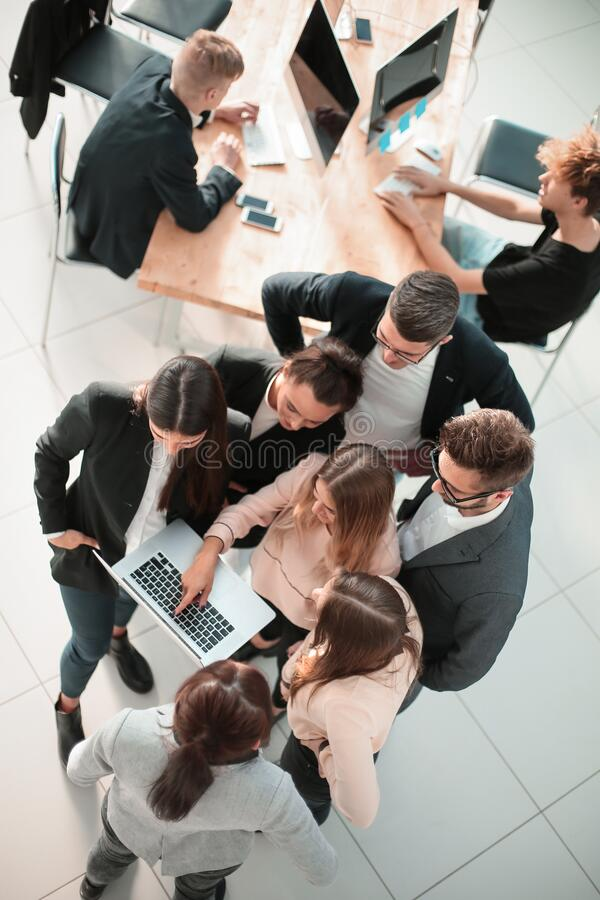 Top view. business team together pointing at the laptop screen. stock photo