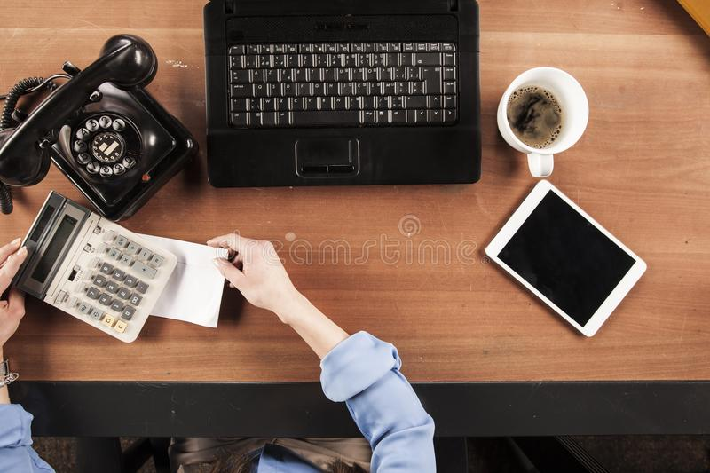 Top view, business woman hiding an envelope with a bribe stock photography