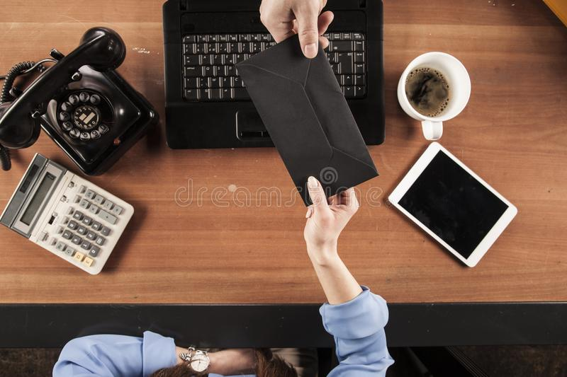 Top view, business woman holding an envelope with a bribe royalty free stock photo