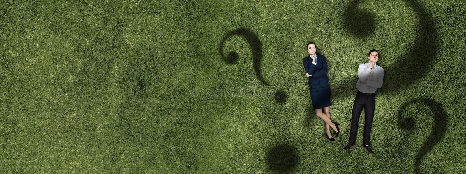Pensive businessman and woman stock image