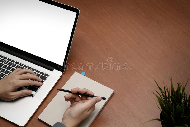Top view of businessman hand working with new modern blank scre stock photography