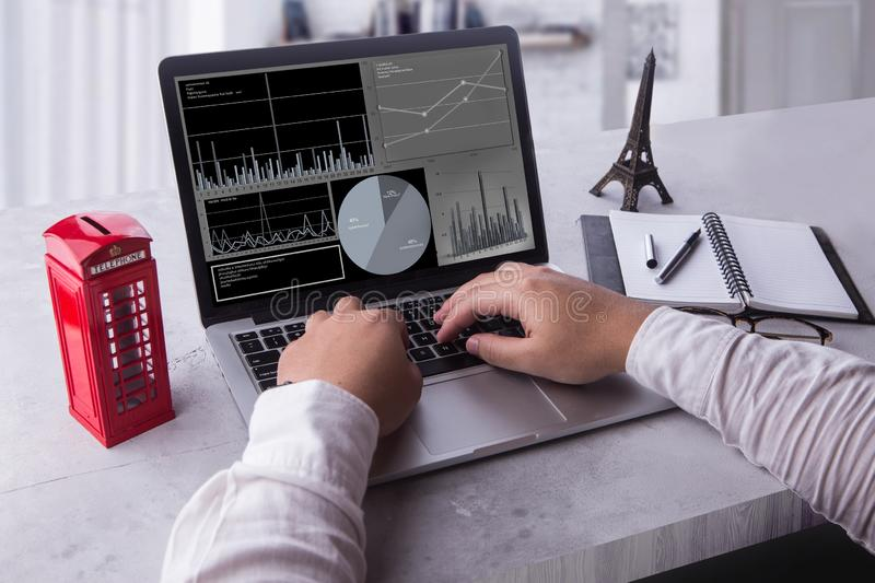 Top view of businessman using laptop computer with statistics data on a screen. royalty free stock photos