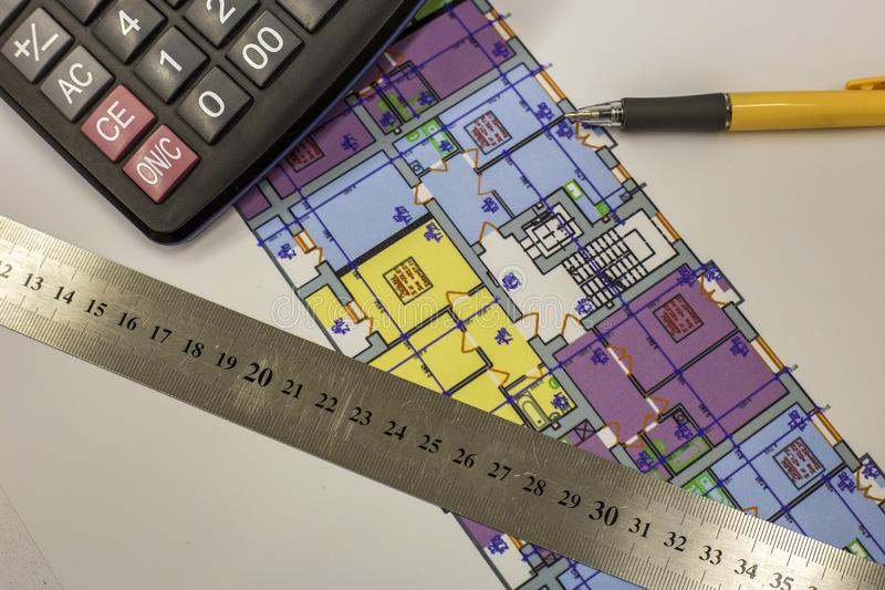 Top view of calculator, pen and ruler on blueprint plan of architecture building. Planning, measurement and investments concept stock photography