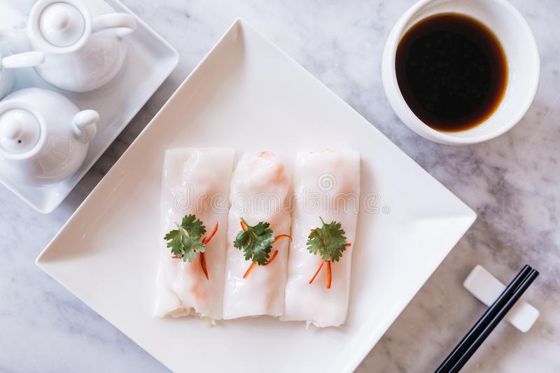 Top view of Cantonese fresh shrimp spring rolls with sour sauce served in white plate on marble top table royalty free stock photography