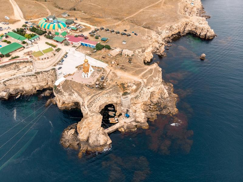 Top view of the cape with a hole where the church stands. Crimea royalty free stock image