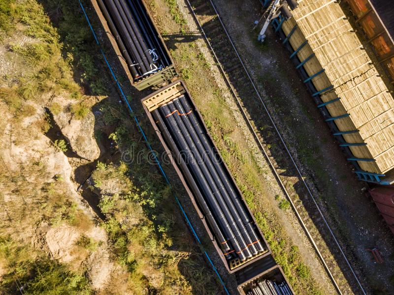 Top view of cargo train transport industrial pipe tube f stock images