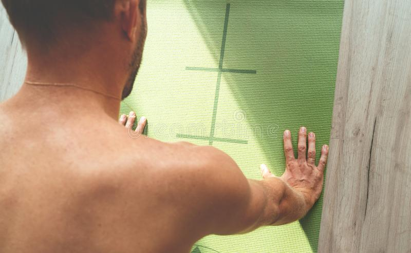 Top view of caucasian male making a full plank on gym mat in the morning. Healthy body concept image. stock photography