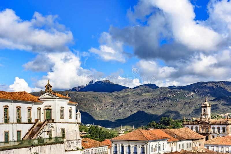 Top view of the center of the historic Ouro Preto city in Minas Gerais. Brazil with its famous churches and old buildings with hills in background royalty free stock image